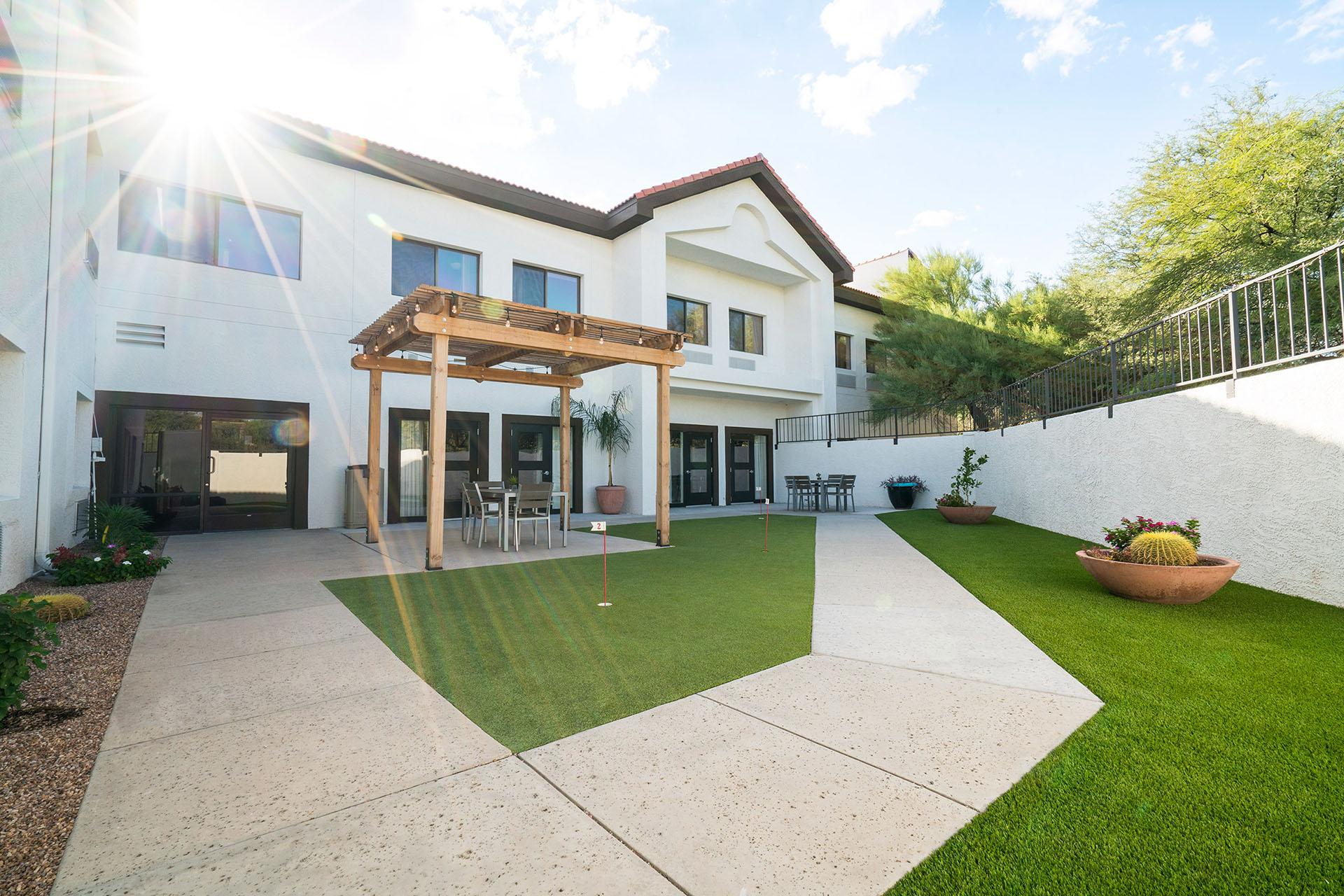A green lawn and pergola