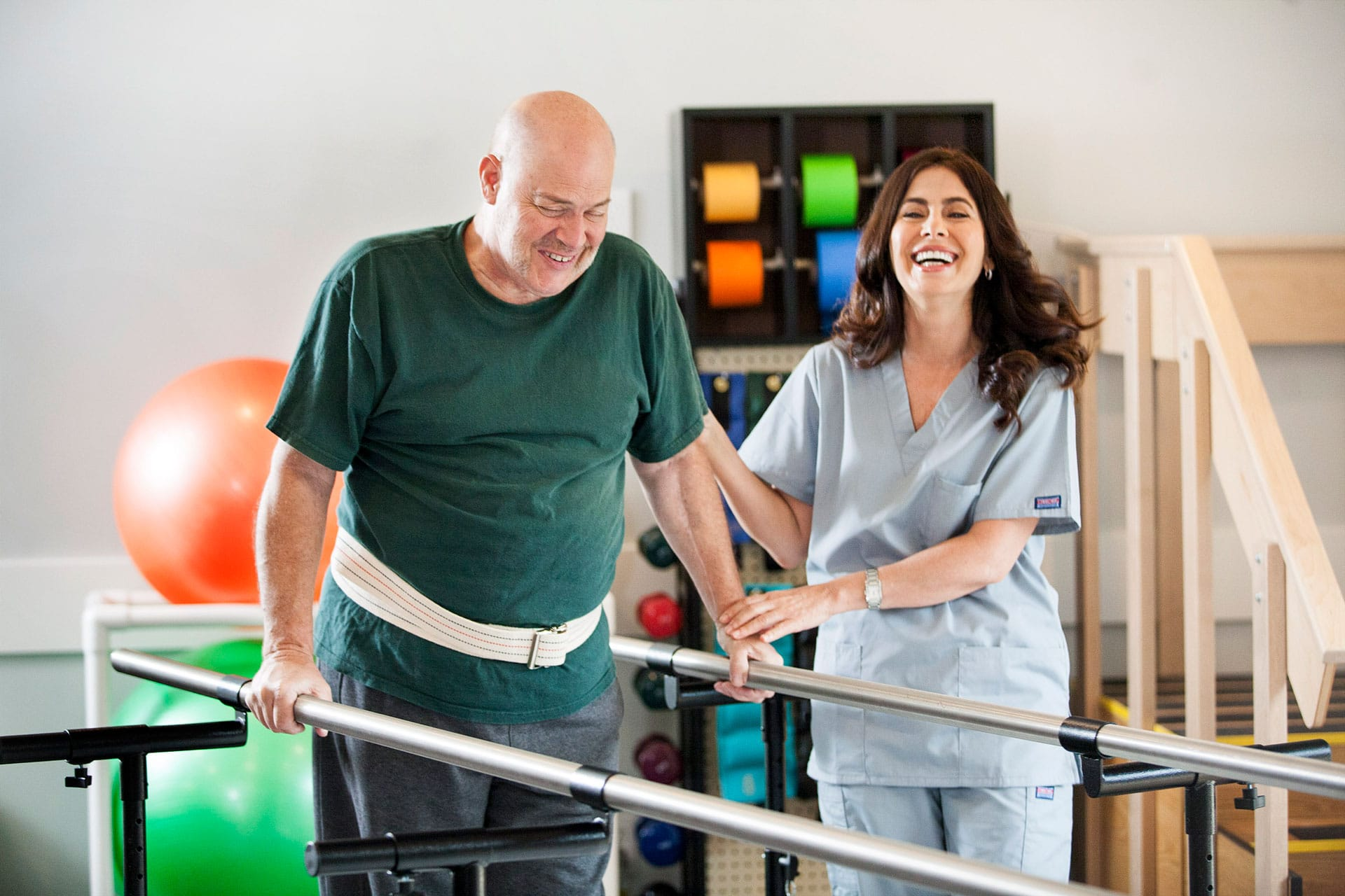 patient relearning to walk with help from occupational therapist