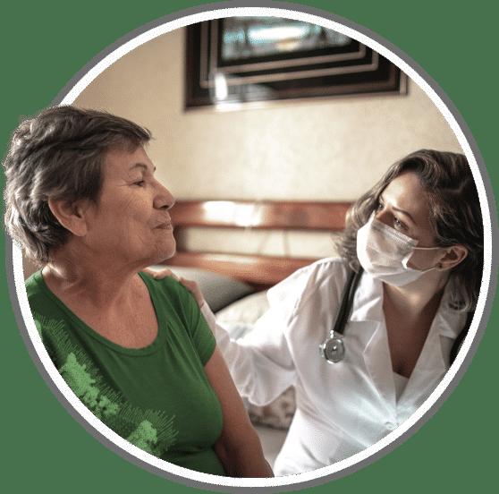 licensed nurse checking on elderly patient