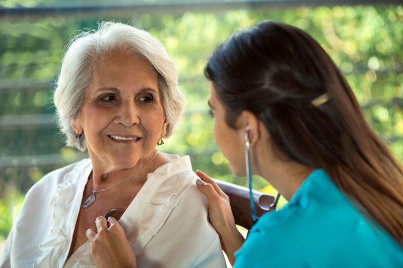 Nursing Assistant taking a patient's vitals