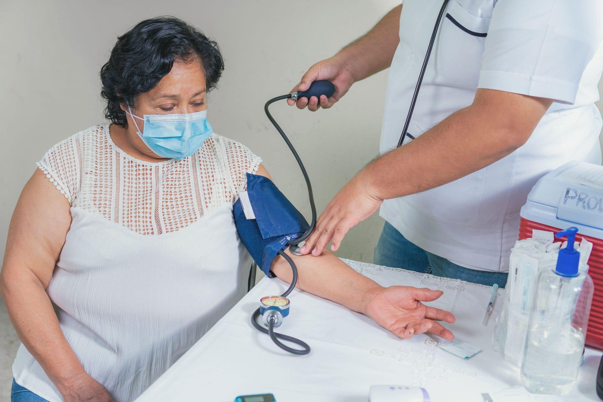 Skilled nursing professional taking patient vitals