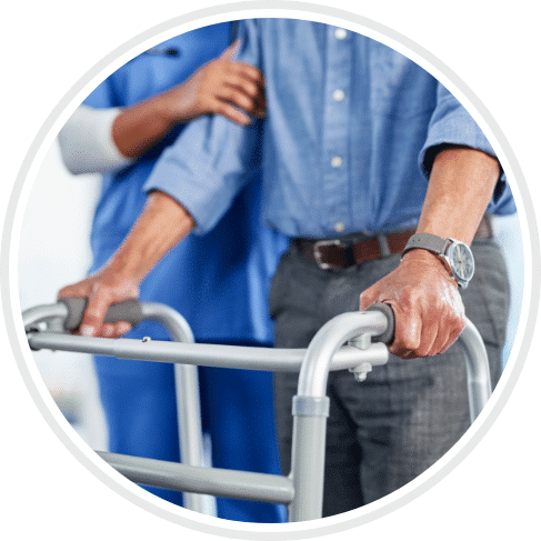 male patient walking with walker and help from the nurse